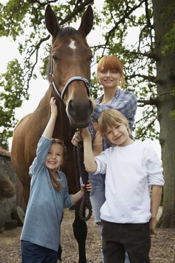 Woman and 2 girls with horse