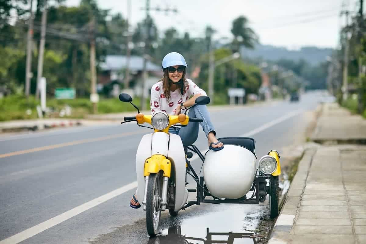 Woman on motorcycle with sidecar