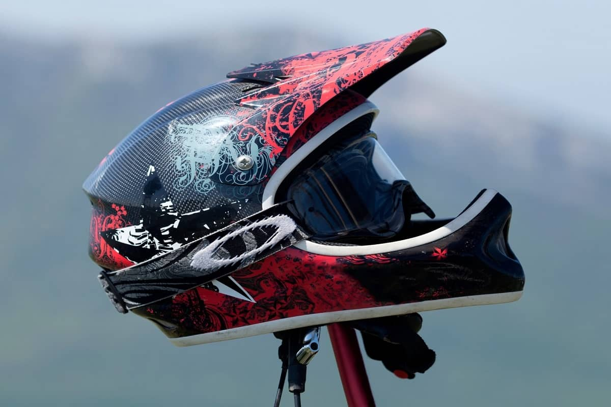 Red Full-Face mountain bike helmet with goggles.