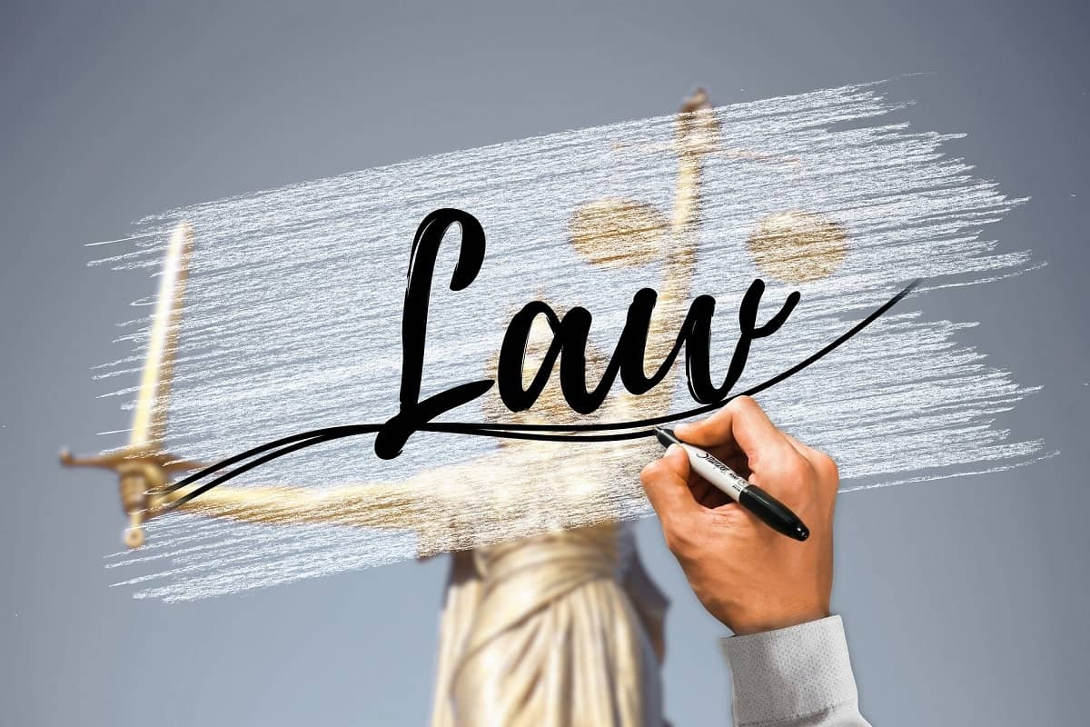The word Law written on a frosted glass window