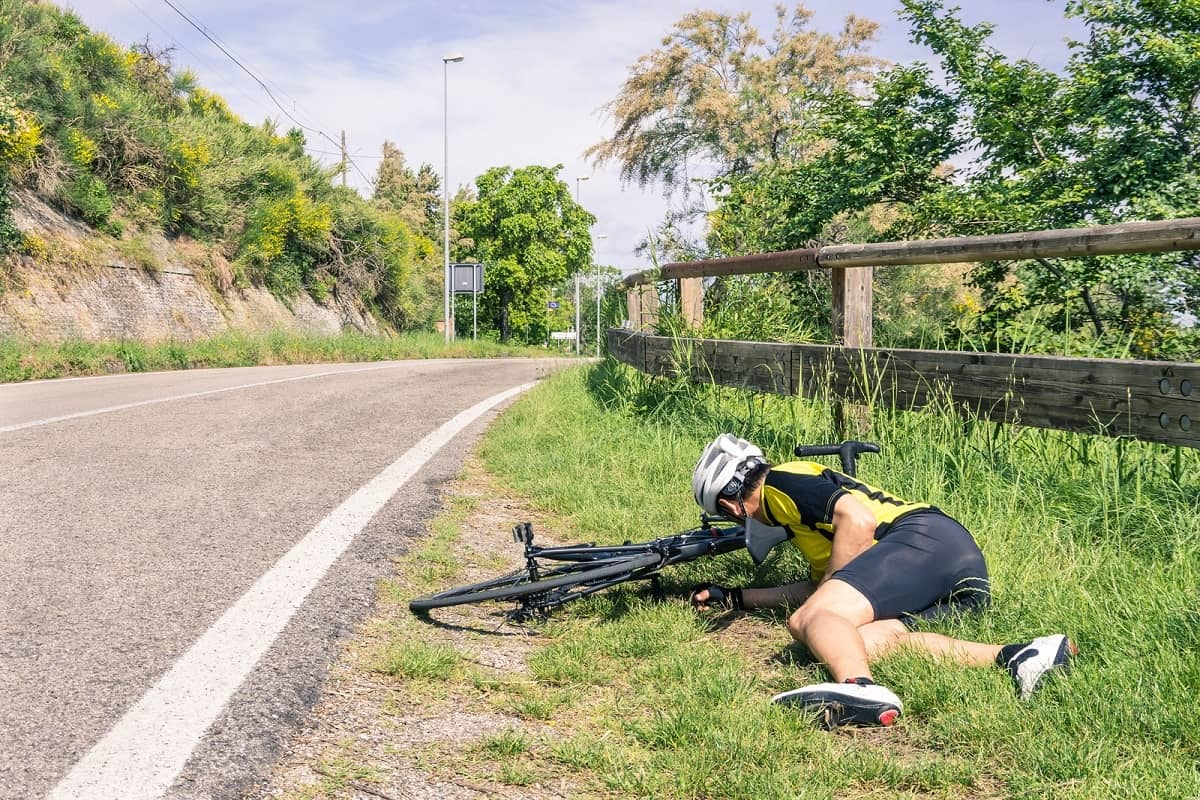 Bicycle and cyclist crashed on side of country road