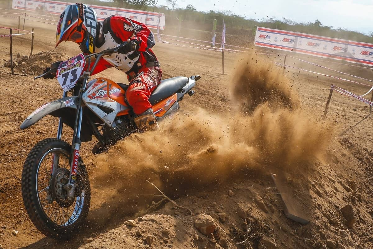 Dirt bike kicking up some roost