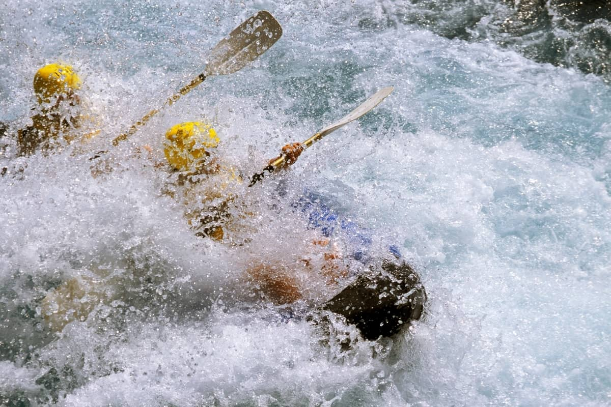 Kayakers in white water rapids